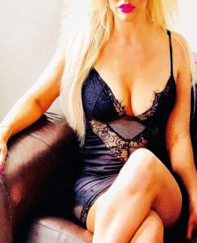 Escort Sienna Manchester Bolton Blackburn on couch